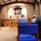 Praying in a chapel